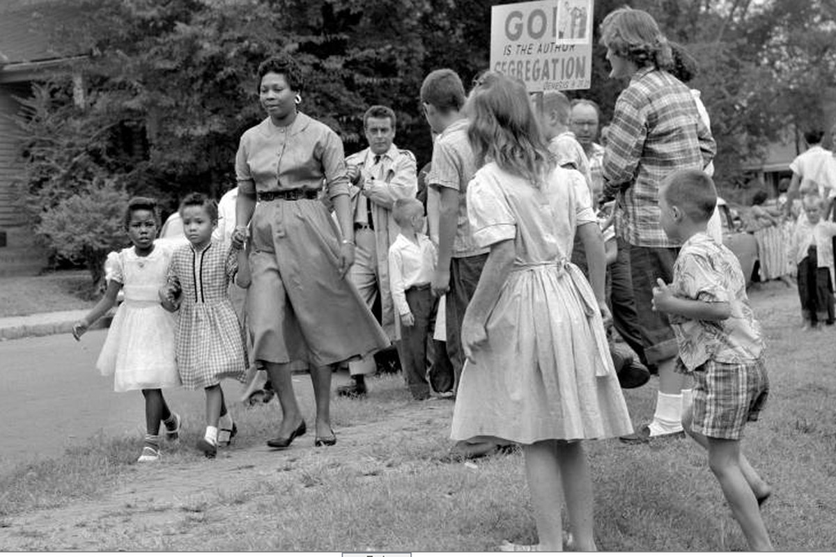 Grace McKinley escorts her daughter Linda Gail and a friend to Fehr Elementary School in Nashville in September 1957 amid Nashvillians protesting desegregation of the city's schools.
