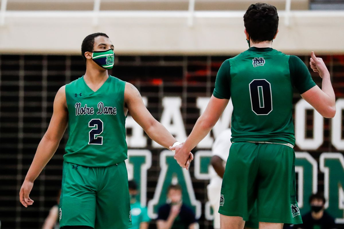 Notre Dame's Anthony Sayles (2) and Troy D'Amico (0) interact during the game against St. Patrick.