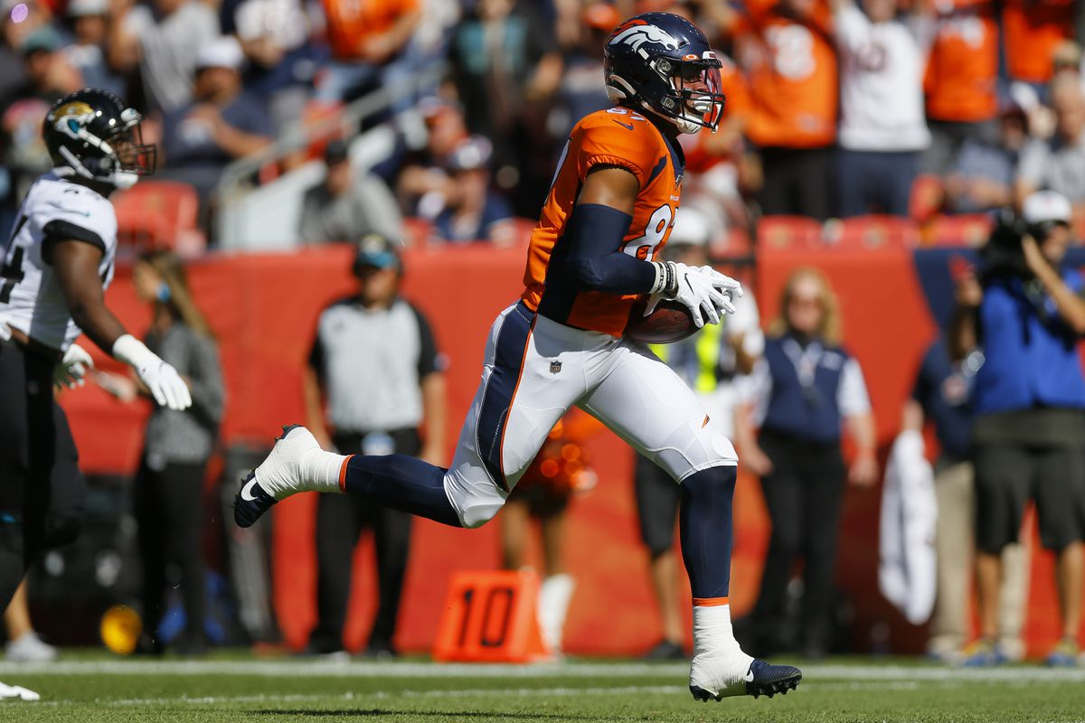 Tight end Noah Fant #87 of the Denver Broncos runs with the football for a first quarter touchdown against the Jacksonville Jaguars at Empower Field at Mile High on September 29, 2019 in Denver, Colorado.