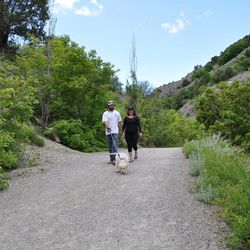 Rob and Katie Carpen of Boise walk along the River Trail with their dog Gus.