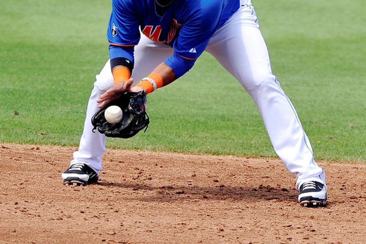 March 27, 2012; Port St Lucie, FL, USA;   New York Mets shortstop Ronny Cedeno (13) makes a play against the Atlanta Braves during a spring training game at Digital Domain Park. Mandatory Credit: Brad Barr-US PRESSWIRE