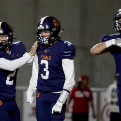 Brighton's quarterback Jack Johnson (2) celebrates with Dante McMaster (3) and Nash Matheson (8) after McMaster scored against East at Brighton High School in Cottonwood Heights on Thursday, Sept. 22, 2021.
