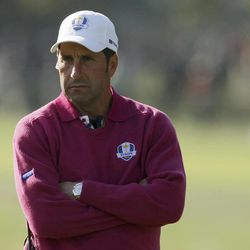 European team captain Jose Maria Olazabal watches from the ninth hole during a foursomes match at the Ryder Cup PGA golf tournament Saturday, Sept. 29, 2012, at the Medinah Country Club in Medinah, Ill.