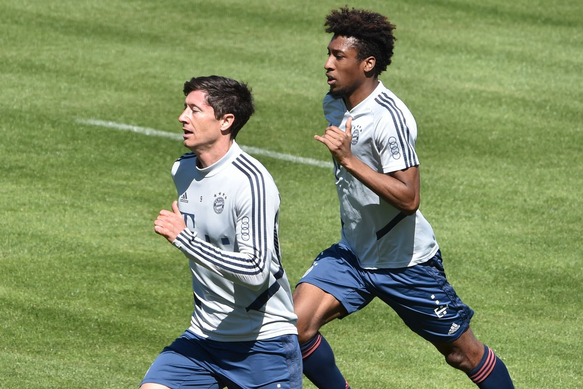 Bayern Munich's Polish forward Robert Lewandowski and his teammate Bayern Munich's French forward Kingsley Coman run during a training session at the football team's training grounds in Munich, southern Germany, on April 22, 2020.