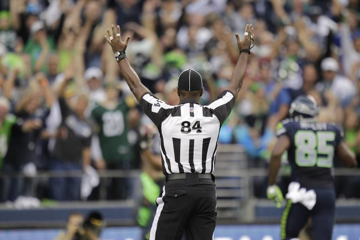 An official during first half of an NFL football game between the Green Bay Packers and Seattle Seahawks, Monday, Sept. 24, 2012, in Seattle. (AP Photo/Ted S. Warren)