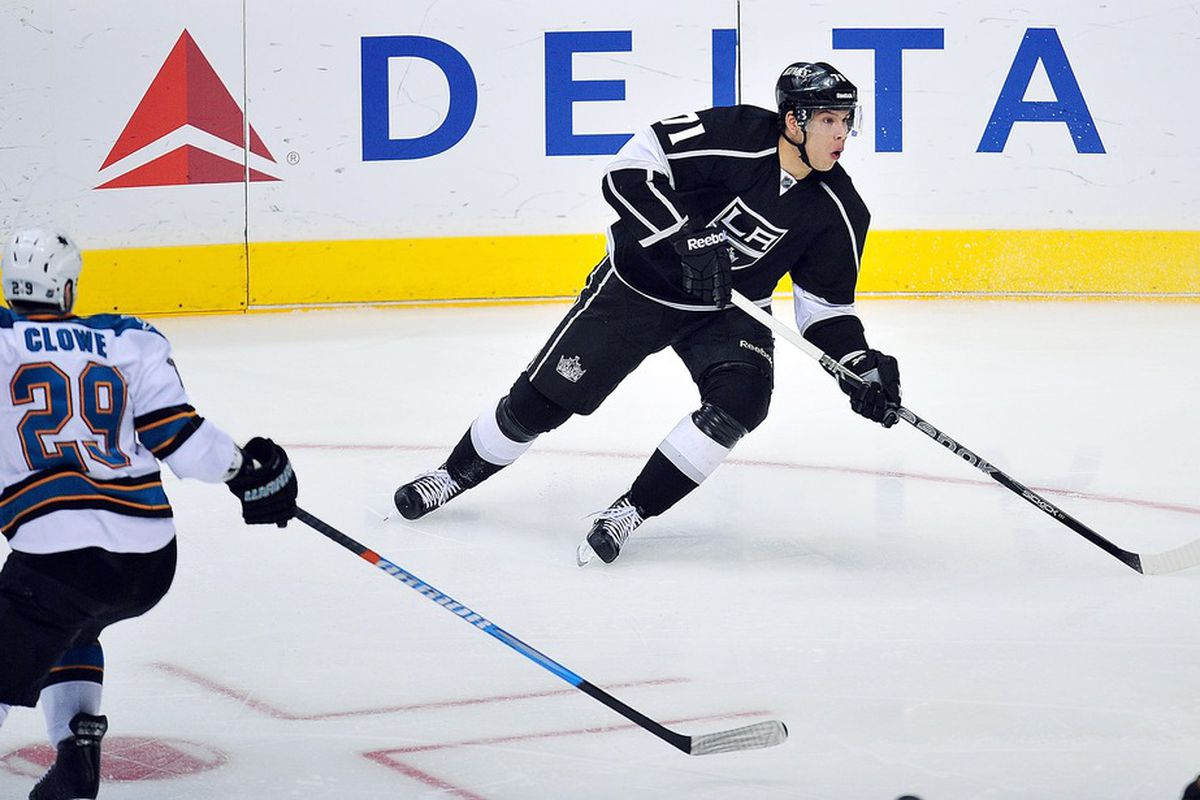 March 20, 2012; Los Angeles, CA, USA; Los Angeles Kings center Jordan Nolan (71) controls the puck against the San Jose Sharks during the second period at Staples Center. Mandatory Credit: Gary A. Vasquez-US PRESSWIRE