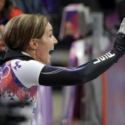 Noelle Pikus-Pace of the United States waves to supporters after her third run during the women's skeleton competition at the 2014 Winter Olympics, Friday, Feb. 14, 2014, in Krasnaya Polyana, Russia. (AP Photo/Dita Alangkara)
