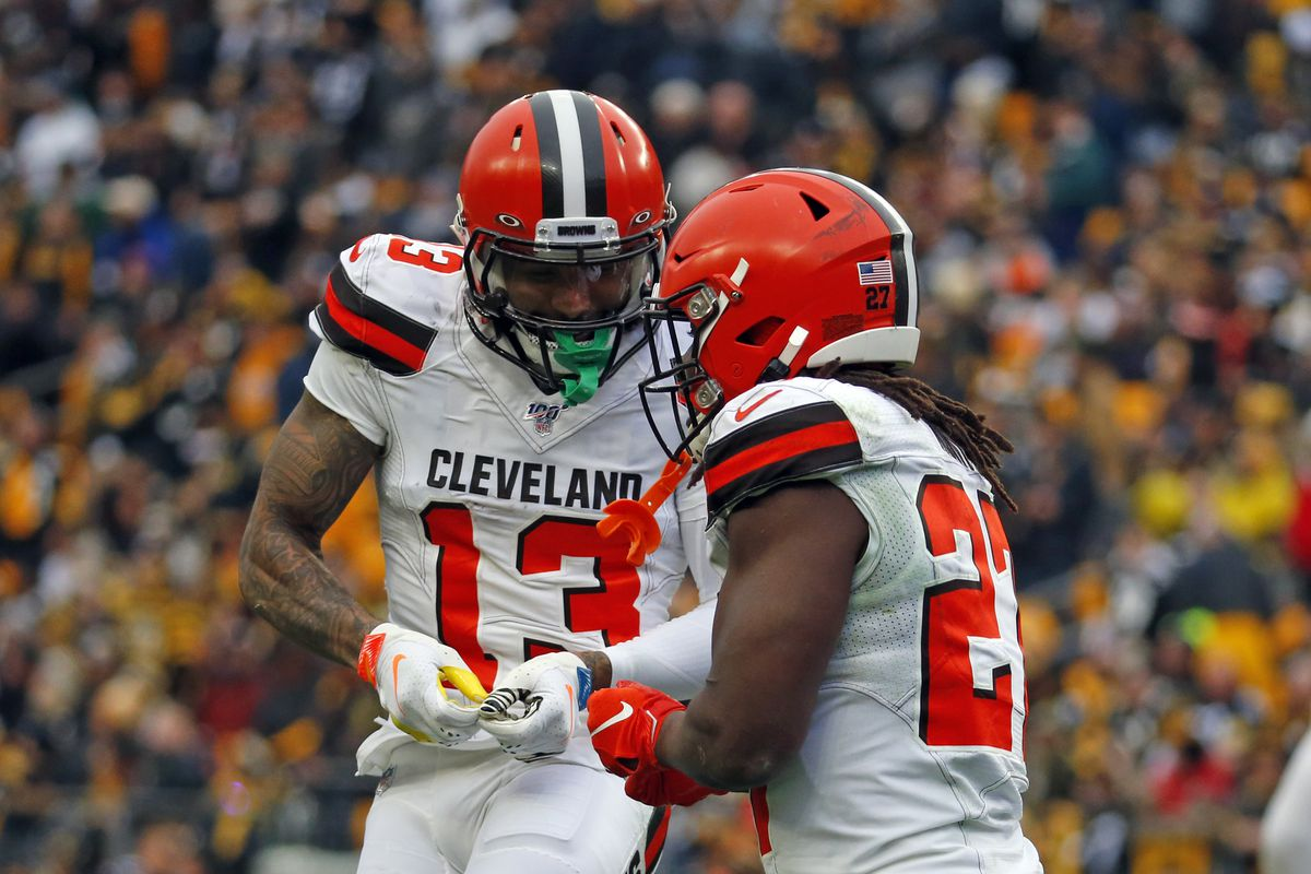 Kareem Hunt of the Cleveland Browns celebrates with Odell Beckham after scoring on a 15-yard touchdown pass in the first half against the Pittsburgh Steelers on December 1, 2019 at Heinz Field in Pittsburgh, Pennsylvania.