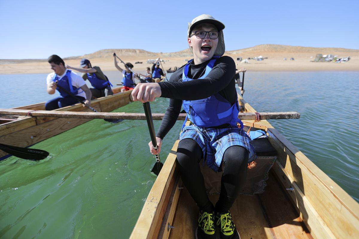 Landon Pearce, a visually impaired 10th grader at the Utah Schools for the Deaf and the Blind, paddles with his team on Lake Powell.
