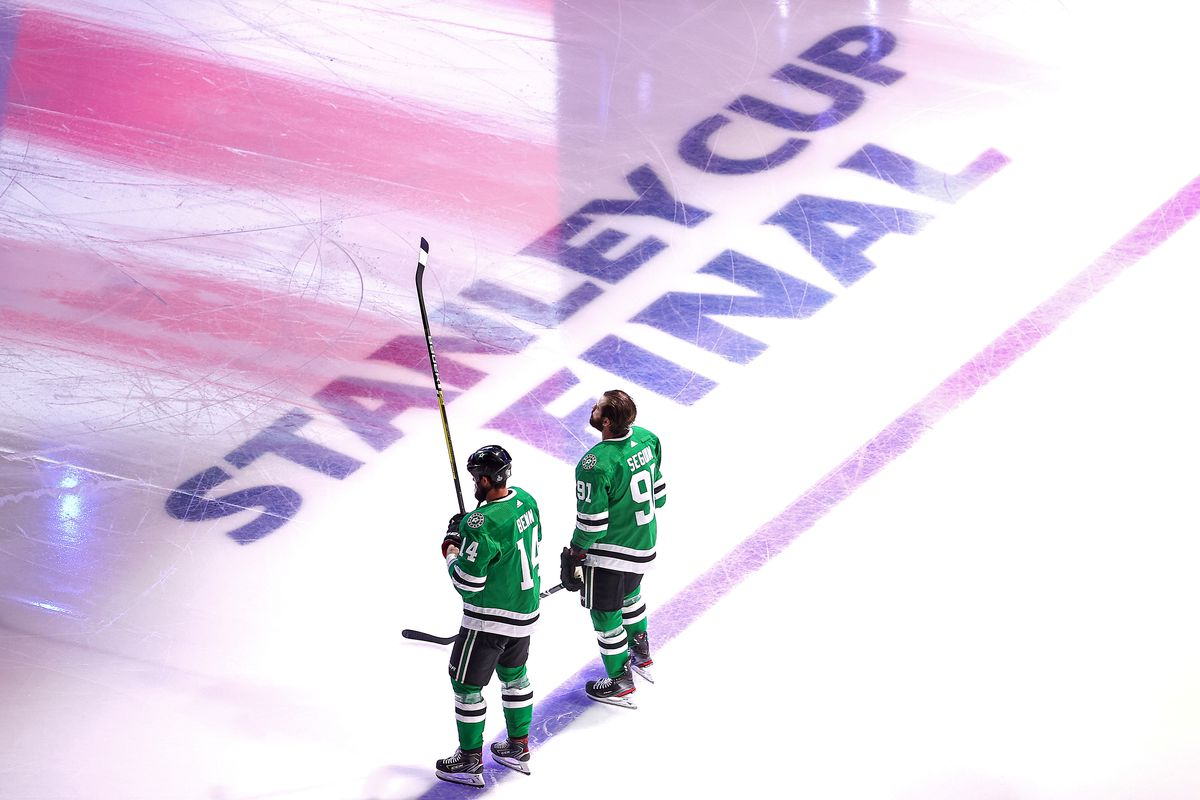 Jamie Benn and Tyler Seguin stand before the National Anthem in the Stanley Cup Final opposite the Tampa Bay Lightning.