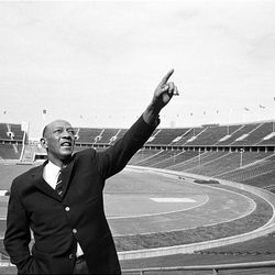 Jesse Owens makes a nostalgic visit to the scene of his great 1936 Olympic triumph in Berlin, Germany, on June 9, 1964. The performance of Jesse Owens will be honored in the stadium where he won four gold medals at the 1936 Olympic Games when the world championships are held in Berlin this month.