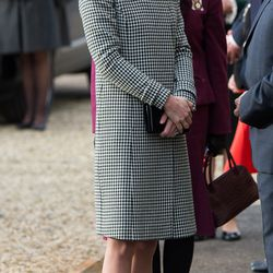 Dressed in a Reiss wrap coat and Stuart Weitzman pumps to visit an addiction treatment center in England on December 10th, 2015. The clutch is Mulberry.