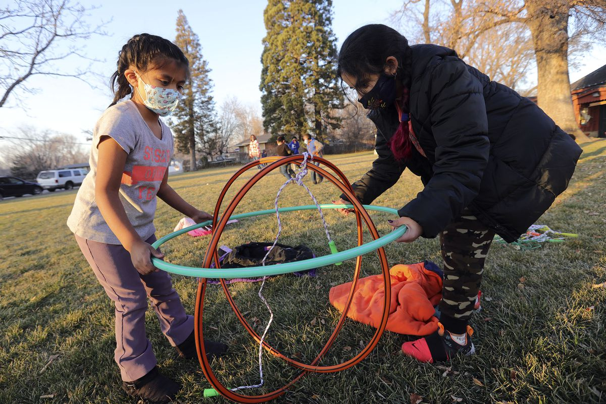 Sarai and Fatima play with hula hoops during Promise South Salt Lake's after-school program at the Historic Scott School in South Salt Lake on Tuesday, Dec. 8, 2020.