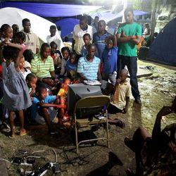 A single television and video game device attracts a group at the Petionville meetinghouse in Petionville, Haiti near in Port-au-Prince, Haiti on Wednesday, Jan., 27, 2010.