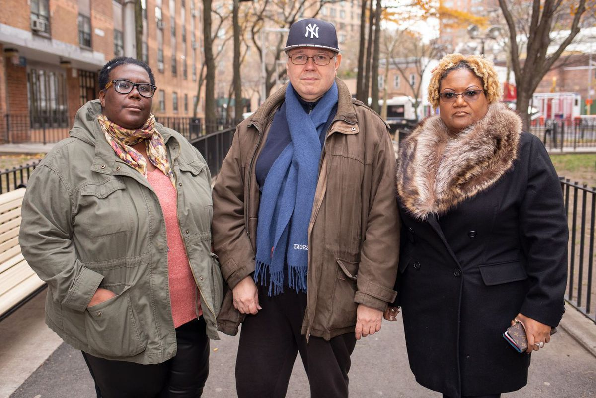Tenant organizers La Keesha Taylor, left, Jose Guevara, and Saundrea Coleman