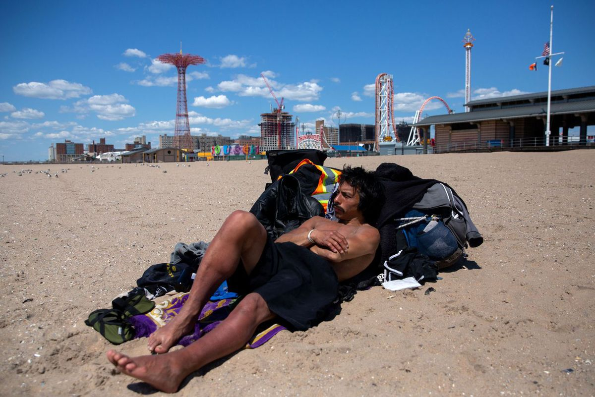 Navy veteran DaSolovo Imeen said he spends time every morning on the Coney Island beach to get some fresh air and sun.