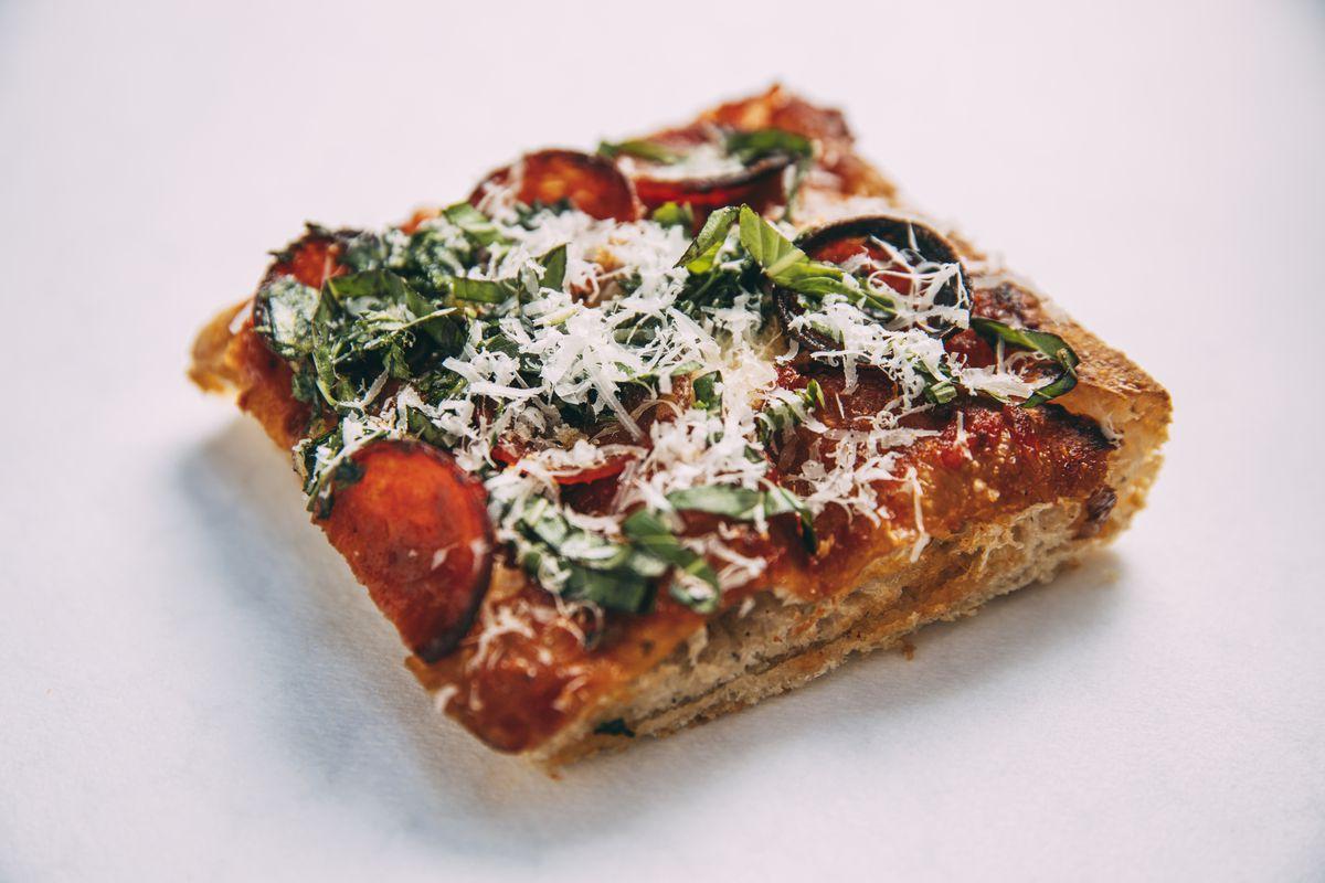 A square slice of Sicilian-style pizza