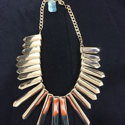 Gold necklace, $20