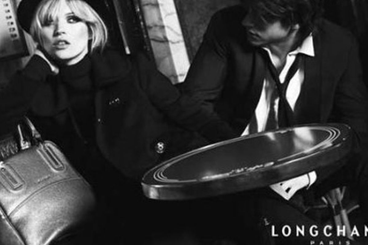 Kate Moss and her Longchamp bag are bored by you. From the fall 2008 campaign.
