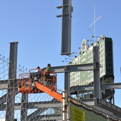 Steel beam being put in place in right field -