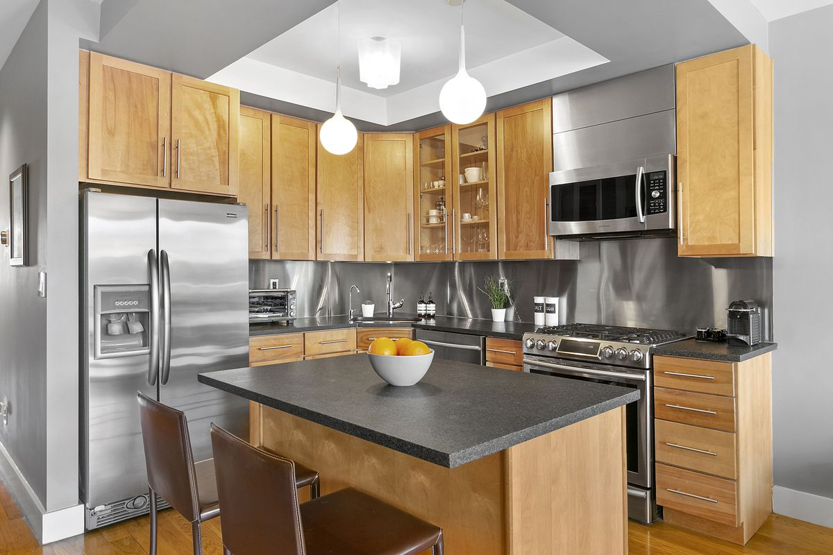 A kitchen with oak cabinetry.