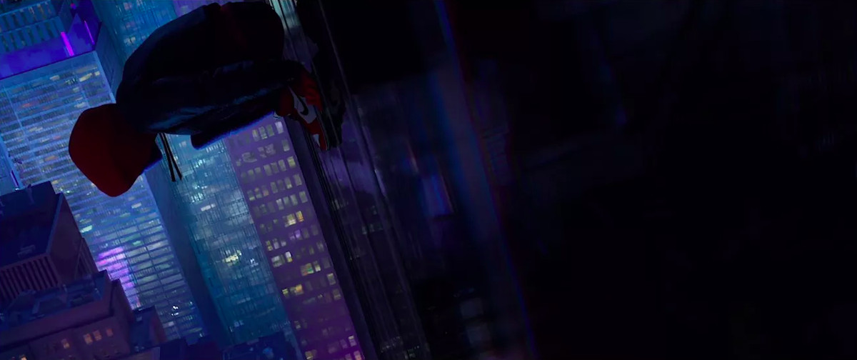 Miles Morales in Spider-Man: Into the Spider-Verse, hanging on the side of a building while wearing Jordans.
