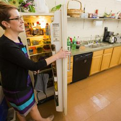 Mary Anne Davies, a recent graduate of Loyola Law School, talks Monday, June 23, 2014, about her fellowship at the Disability Law Center in Salt Lake City. Mary Anne gets her lunch out of the refrigerator.