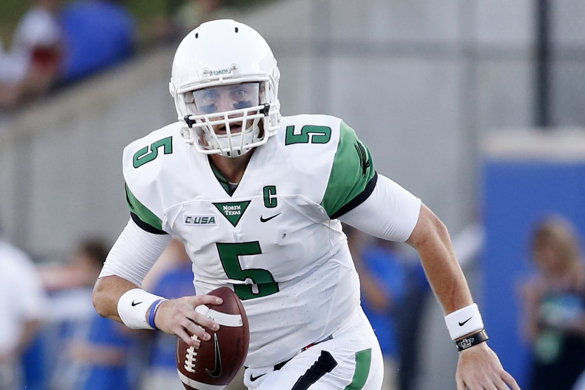North Texas QB Andrew McNulty rolls out against SMU in their season opener.