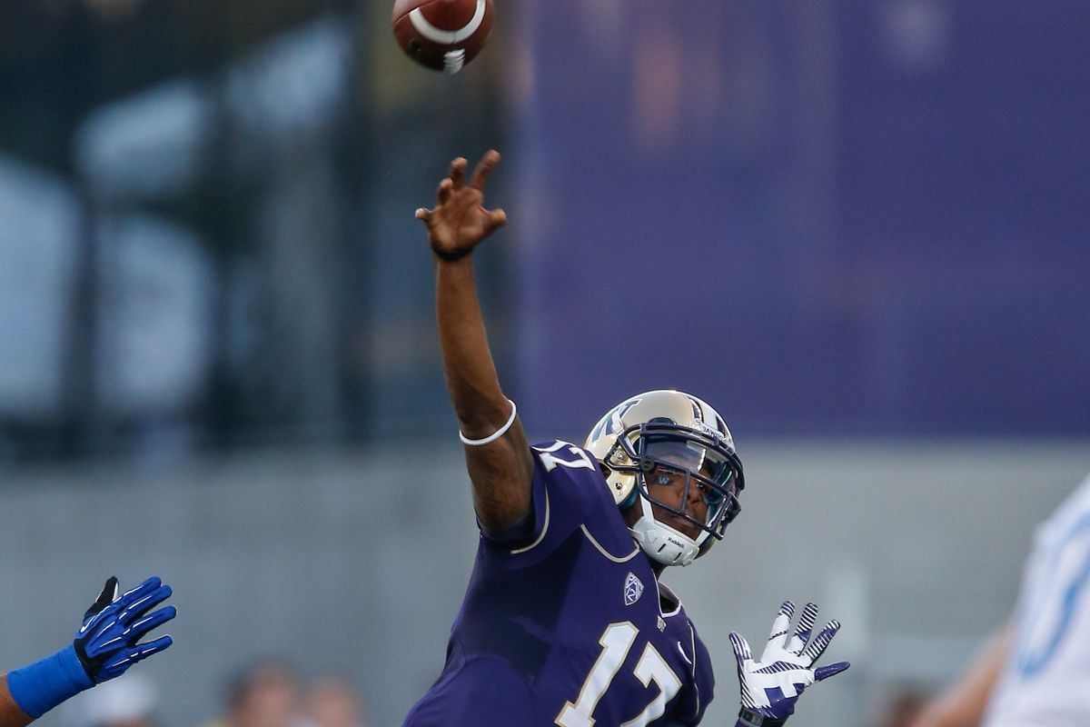 Husky QB Keith Price is showing off some good form against Boise St.