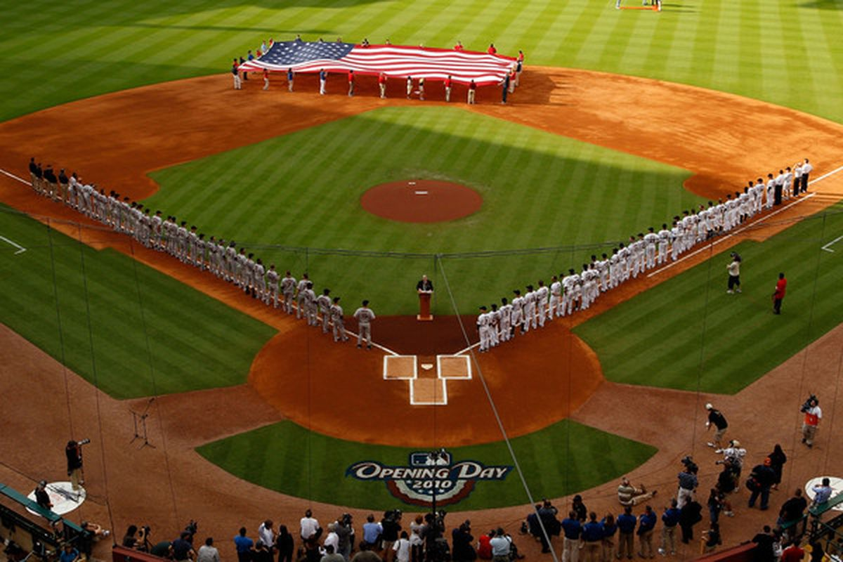 HOUSTON - APRIL 05:  Members of the San Francisco Giants and the Houston Astros stand on the field during pre-game activites on Opening Day at Minute Maid Park on April 5, 2010 in Houston, Texas.  (Photo by Chris Graythen/Getty Images)