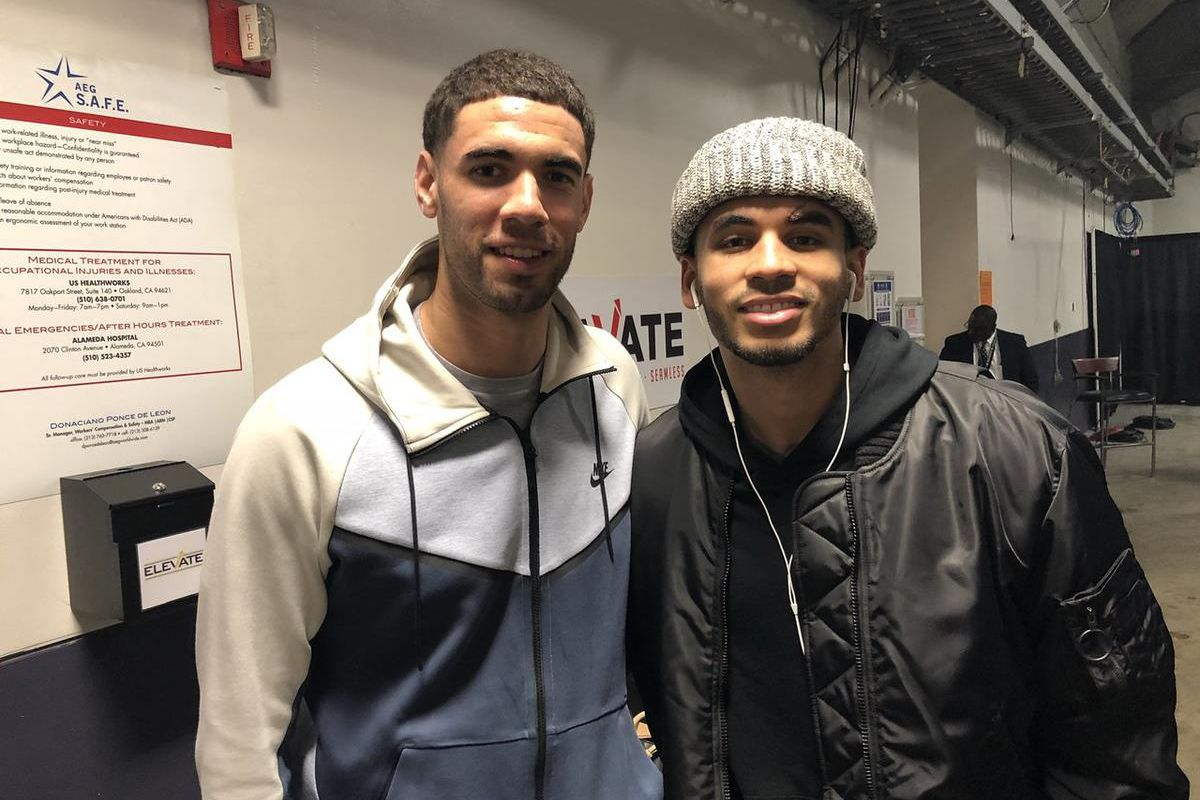 New Jazz signee Georges Niang, left, poses with college teammate and former Jazz guard Naz Mitrou-Long, right, at Oracle Arena in Oakland, California on Wednesday, Dec. 27, 2017.