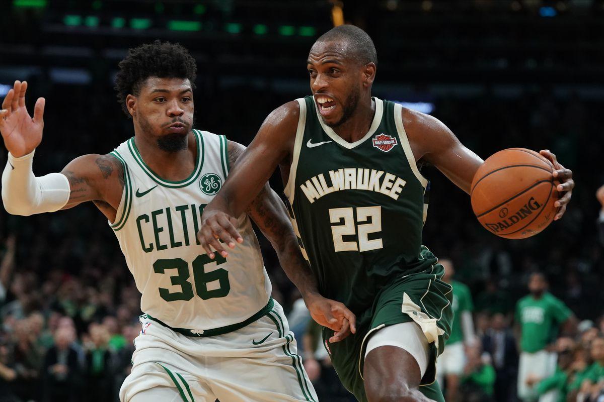 Milwaukee Bucks forward Khris Middleton drives to the basket against Boston Celtics guard Marcus Smart at TD Garden.