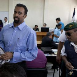 In this Aug. 20, 2012 photo, U.S citizen Jason Sachary Puracal, left, attends his appeals hearing in handcuffs in Granada, Nicaragua.  As a three-judge appellate panel mulls the 35-year-old American's fate, the case has drawn the scrutiny of U.S. lawmakers and human-rights advocates, including the California Innocence Project, which works to absolve people who have been wrongfully convicted. In late 2010 masked policemen raided his seafront real estate office and took him to Nicaragua's maximum security prison. Prosecutors charged that Puracal was using his business as a front for money laundering in a region used to transport cocaine from Colombia to the United States. Because no drugs or cash were seized, Puracal's family and friends thought he wouldn't be held long, but nine months later, a judge convicted Puracal and sentenced him to 22 years in prison.