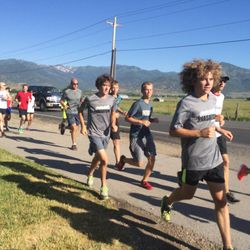 Wasatch senior cross-country runner Josh Collins leads the pack of runners back to South Field Park after a short warm-up run with Olympian Ryan Hall.