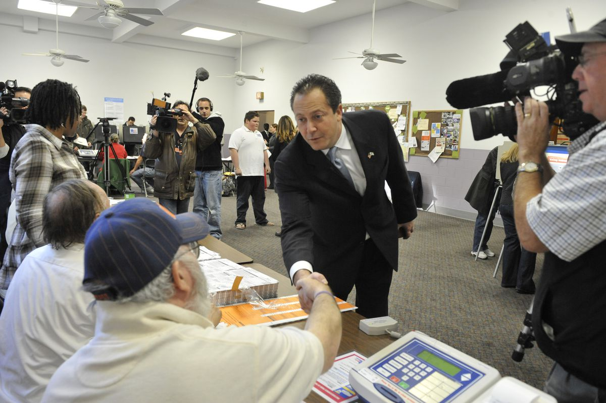 Scott Lee Cohen greets election judges before voting in 2010.
