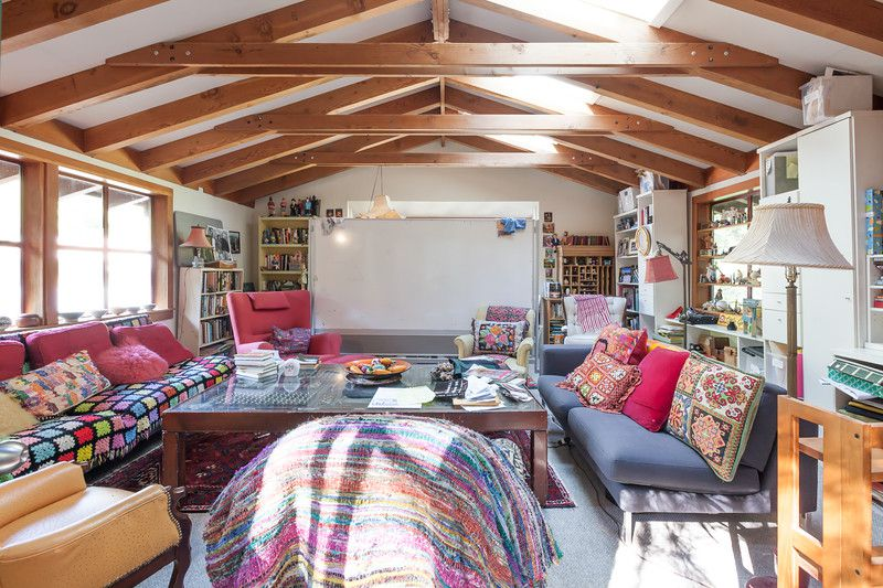 Joyce Maynard's writing studio above her garage has all she needs for writing: a whiteboard, comfortable chairs, windows, and a big desk.