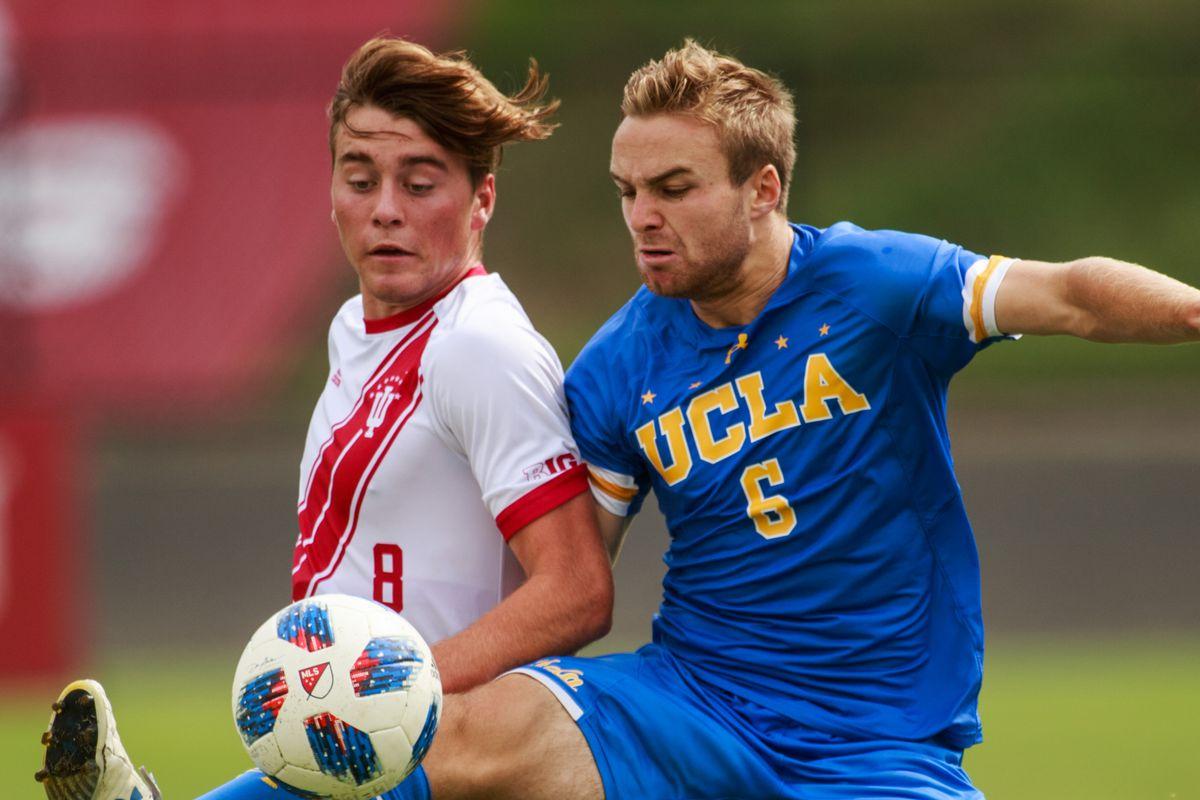 Indiana University soccer player Aidan Morris (8) and UCLA's...
