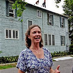 New Orleans homeowner Elizabeth Calvit talks about the length of time it has taken to get workers to install a new roof on her home in New Orleans. Calvin signed a roofing contract on her century-old home in October and was still pushing to complete the job in May. Hurricane season officially started on June 1.