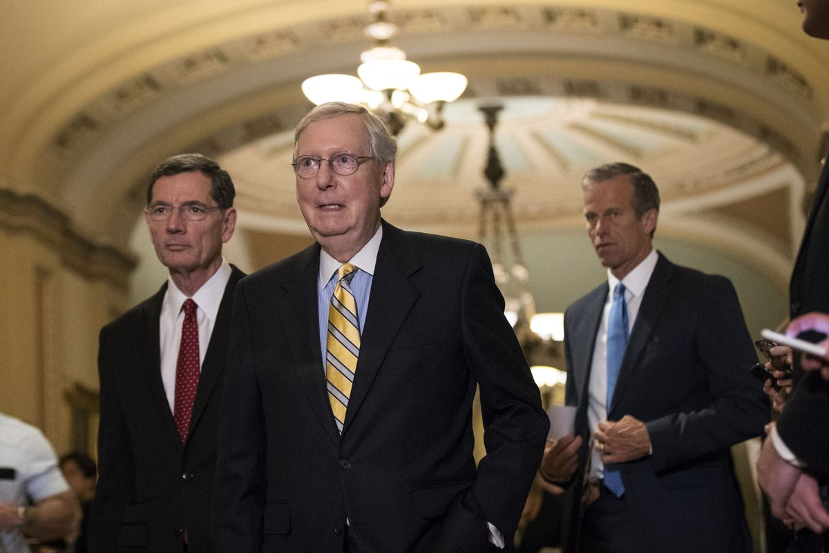Mitch McConnell and Sen. John Thune arrive for a press conference after a closed-door Senate GOP conference meeting.