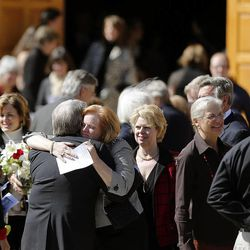 John Huebner, Deedee Corradini's husband, gets a hug following the funeral service for Deedee Corradini at Wasatch Presbyterian Church in Salt Lake City, Monday, March 9, 2015.