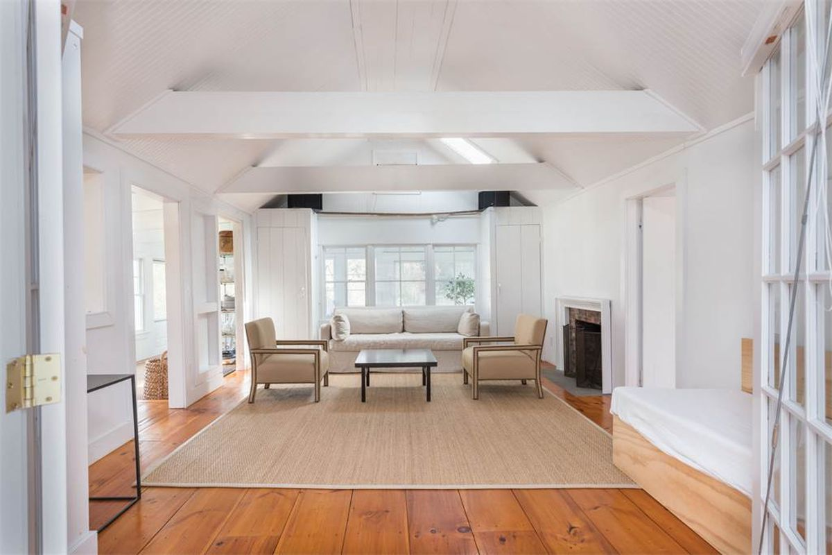 Minimalist sag harbor cottage with bay view on the market for Hardwood floors 1200 square feet