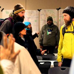 Volunteers gather at Sunrise Metro Apartments before the annual Point In Time Count of unsheltered homeless people in Salt Lake City on Thursday, Jan. 29, 2015.  Chronic homelessness in Utah dropped 91 percent in the past decade under Utah's 'Housing First' initiative, state officials said Tuesday.
