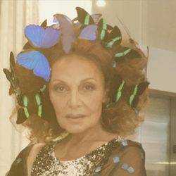 DVF in a headdress made out of butterflies, naturally.