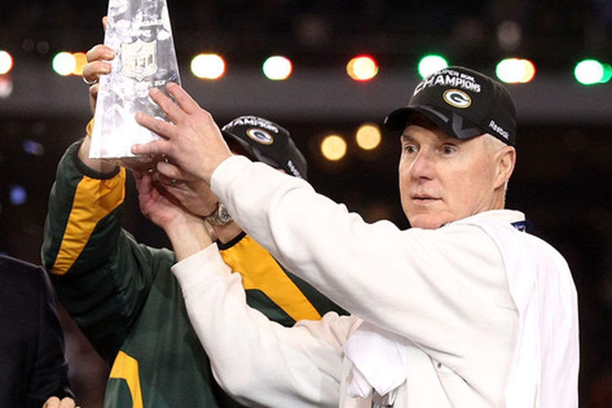 ARLINGTON TX - FEBRUARY 06:  Green Bay Packers General Manager Ted Thompson celebrates after winning Super Bowl XLV 31-25 against the Pittsburgh Steelers at Cowboys Stadium on February 6 2011 in Arlington Texas.  (Photo by Al Bello/Getty Images)
