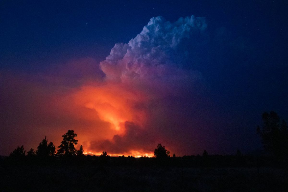 Flames and smoke rise from the Bootleg fire in southern Oregon.