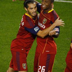 HARRISON, NJ - SEPTEMBER 21:  Fabian Espindola #7 of Real Salt Lake celebrates with teammate Collen Warner #26 of New York Red Bulls on September 21, 2011 at Red Bull Arena in Harrison, New Jersey.  (Photo by Mike Stobe/Getty Images for New York Red Bulls)