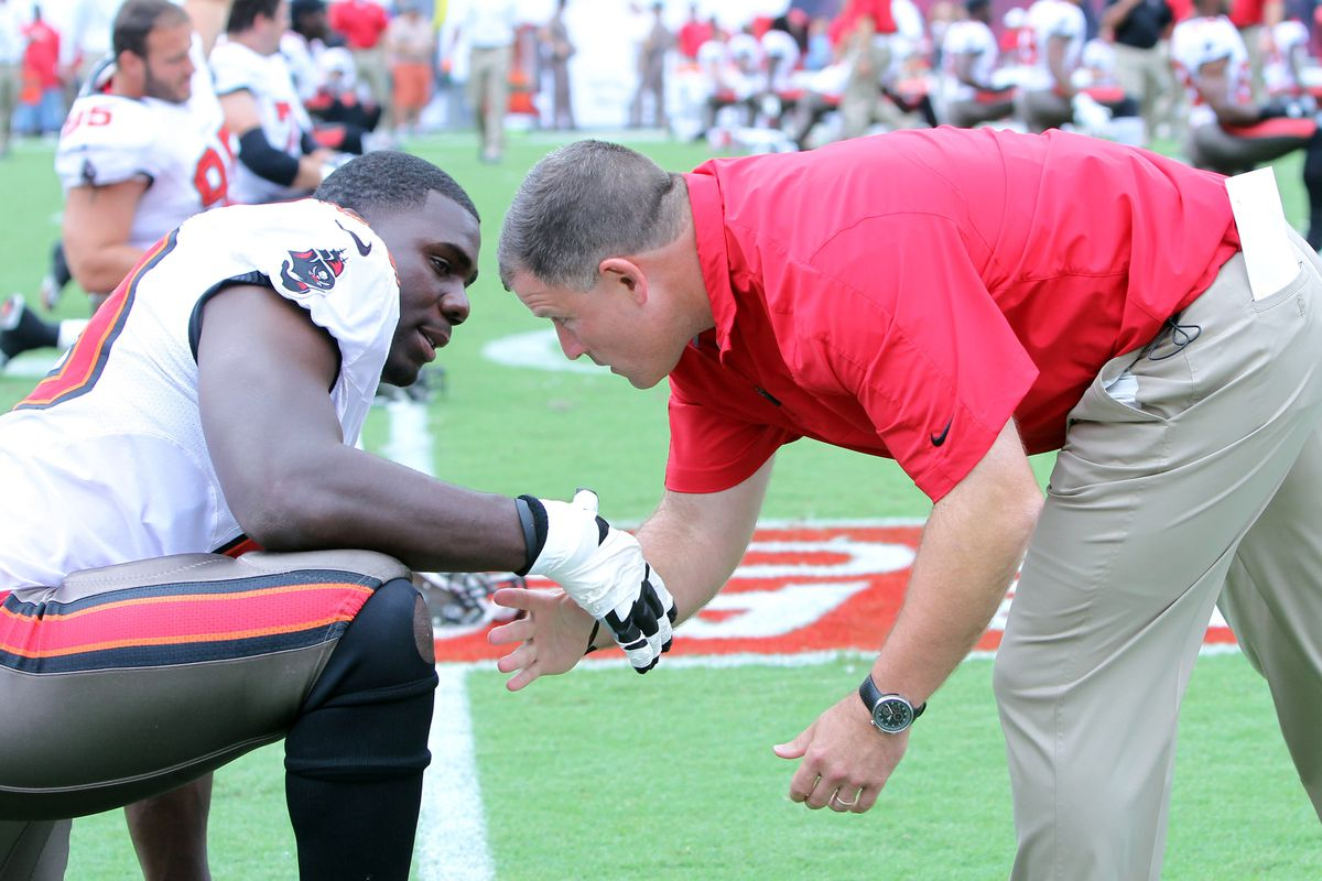 September 9, 2012; Tampa, FL, USA; Tampa Bay Buccaneers head coach Greg Schiano talks with tackle Demar Dotson (69) prior to the game against the Carolina Panthers at Raymond James Stadium. Mandatory Credit: Kim Klement-US PRESSWIRE