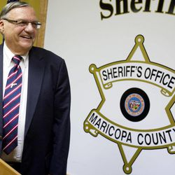 Maricopa County Sheriff Joe Arpaio, talks with Media members Friday night Aug. 31, 2012 at his offices in downtown Phoenix. Federal authorities said Friday that they're closing their abuse-of-power investigation into Maricopa County Sheriff Joe Arpaio in Arizona without filing charges against him.