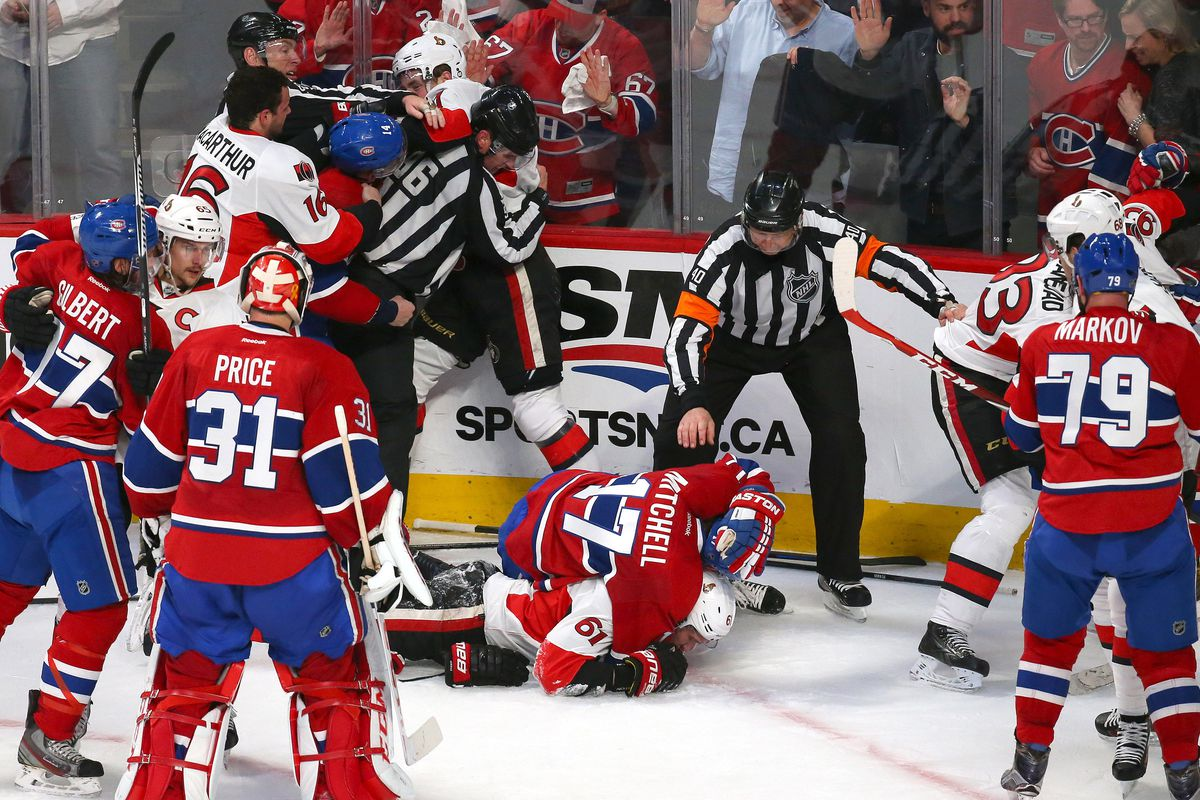Apr 15, 2015; Montreal, Quebec, CAN; The Montreal Canadiens and Ottawa Senators players fight after their game one of the first round of the 2015 Stanley Cup Playoffs at Bell Centre.