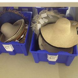 $15 straw hats in the miscellaneous bin